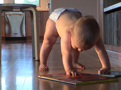 Developmental movement therapy for a young baby trying to stand