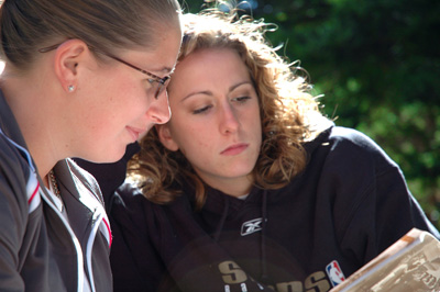 Photo of two high school age girls studying in outdoor setting learning about Brain Gym exercises