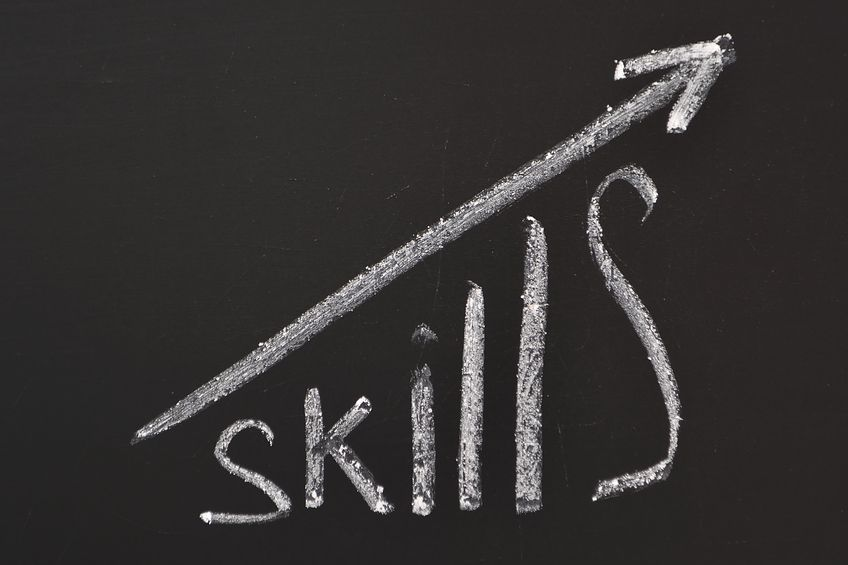 A picture of the word skills written on a chalk board